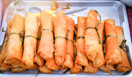 Fried Chinese traditional Spring rolls in street food market Stock Photo