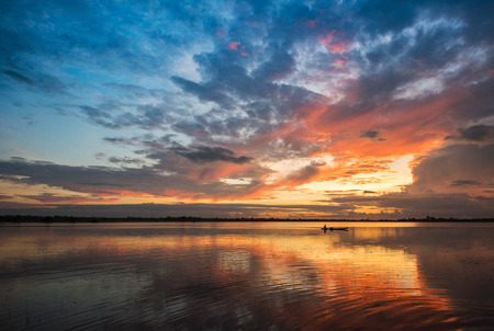 Beautiful river sky and fishing boat sunrise or sunset with colorful sky dramatic cloud background