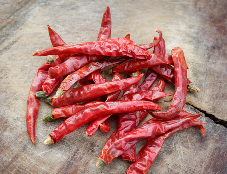dried chilli red on old wooden background