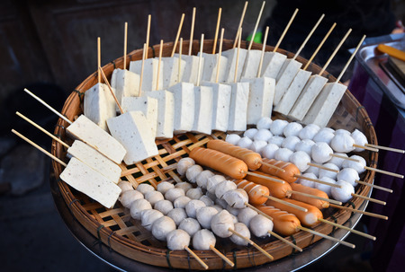 Food steamed sausage meat ball white pork sausage on steamer set made of bamboo for sale in the street food asia