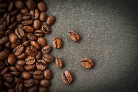 Coffee beans roasted on dark background Stockfoto