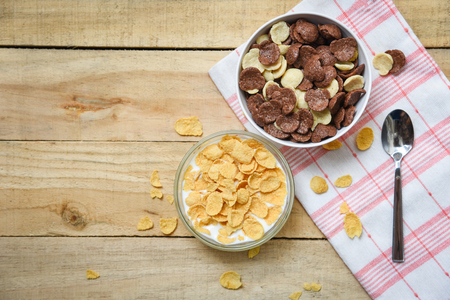 Cornflakes breakfast and various cereals in bowl milk cup on wooden table background for cereal healthy food