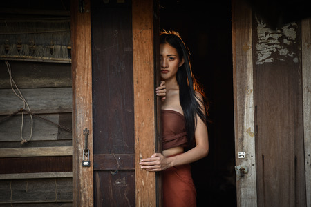 Woman Ghost drama standing on old door in wooden thai house / Horror Legend of Mae Nak Phra Khanong