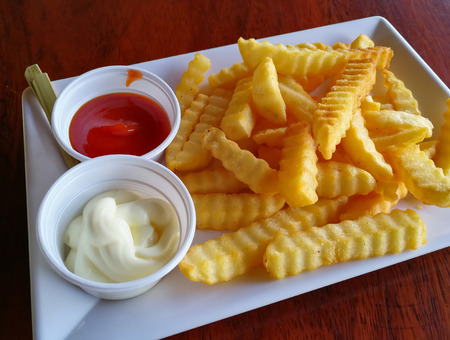 French fries on plate with cream and tomato sauce  Crispy potato french fries ketchup for snack
