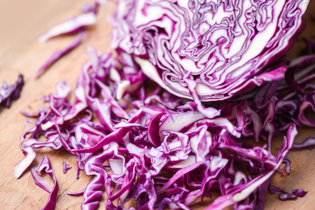 Cabbage purple  Shredded red cabbage slice in a wooden cutting board