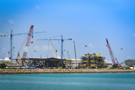 Crane Construction port for container ship in export and import business and logistics in harbor industry coast Standard-Bild - 124847899