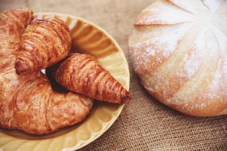 freshly baked croissants  Bakery bread on sack in the table homemade breakfast food concept