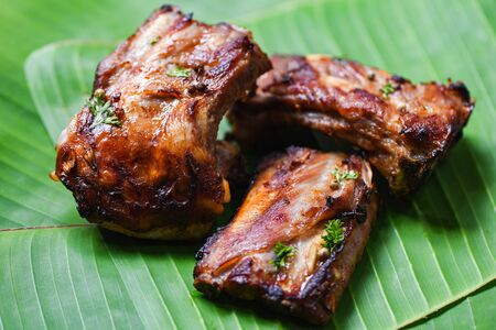 bbq pork ribs grilled with herbs spices served on banana leaf  Roasted barbecue pork spare rib sliced