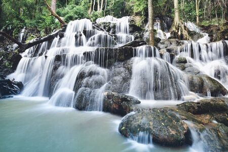 Waterfall landscape forest mountain and bamboo tree wild tropical waterfall thailand jungle river stream on the rock