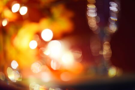 abstract blur bokeh background with light orange and red at night 写真素材