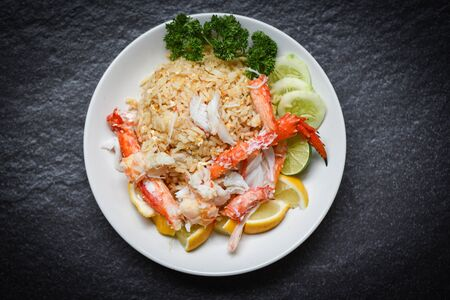 fried rice with crab meat egg lemon and cucumber on white plate seafood healthy food