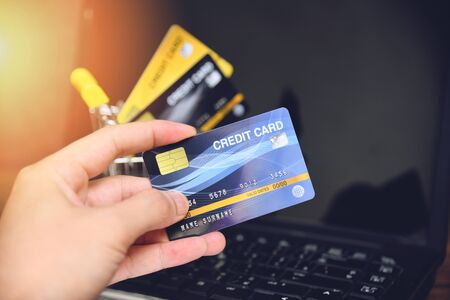 credit card and using laptop easy payment online shopping concept  electronic card in hand for pay online