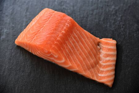 Fresh salmon fillet fish seafood on dark background 写真素材