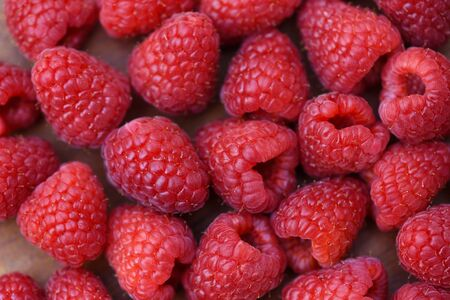 Fresh raspberry texture  Close up red raspberries fruit background top view