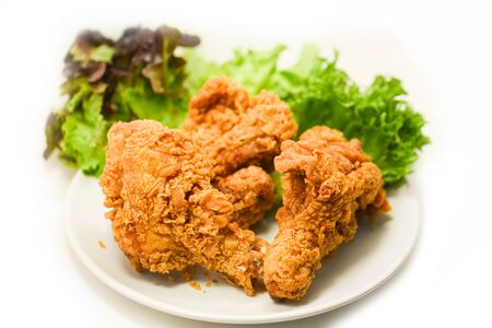 Fried chicken crispy on plate with salad lettuce on white background 写真素材