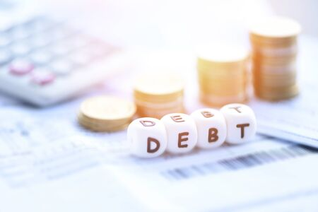 Debt concept with calculator stack coin on invoice bill paper / Increased liabilities from exemption debt consolidationof financial crisis and problems risk business management loan