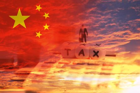 China taxes of goods in export and import logistics trade war / Tax Reform concept and calculator businessman finances 免版税图像