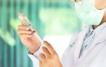 Syringe medication injection and needle in hand nurse asian for giving patient vaccine prophylactic / Medication drug bottle equipment medical tool for doctor liquid drug health care in hospital 版權商用圖片