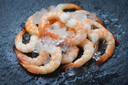fresh shrimps served on plate / boiled peeled shrimp prawns cooked with ice background in the seafood restaurant Imagens