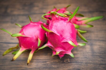 Dragon fruit on wooden nature green background  Fresh pitaya summer tropical fruit concept