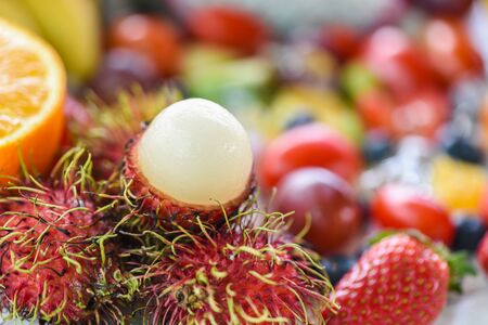 Rambutan peeled and colorful fruit background  Fresh rambutan summer fruit from garden in Thailand