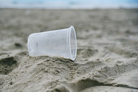 Garbage in the sea with plastic cup on beach sandy dirty sea on the island  Environmental problem of rubbish pollution in ocean Stockfoto
