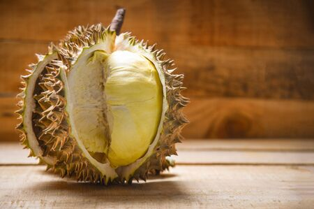 Durian riped  Fresh durian peel tropical fruit on wooden background on summer