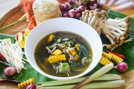 Mushroom soup herbs and spices ingredients Thai food served on bowl / Mix various kinds of mushrooms tradition northeast food Isaan delicious with vegetables pumpkin - Thai menu Asian food Standard-Bild - 128737183