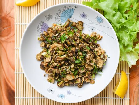 Puff Ball Mushrooms salad spicy with herb and spices on plate lettuce vegetable on table Thai Asian food , selective focus Stockfoto