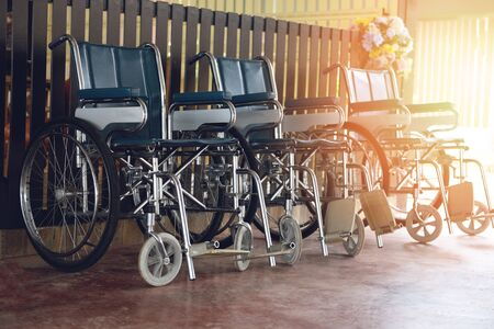 Wheelchairs in the hospital  Wheel chairs waiting for patient services disabled carriage Stockfoto