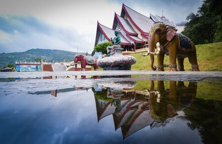 Temple thailand beautiful sky twilight sunset with elephant statue and Indra statue water reflection important religious Buddhist landmarks and Hindu brahmin Stok Fotoğraf