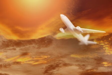 Airplane storm flying in the orange sky with clouds at colorful sunset Travel background  Travelers Airlines plane  dramatic sky and lightning flying at bad weather with red clouds