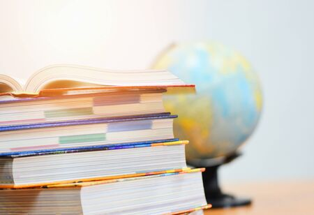 Education concept back to school and business study global world / open book in library with book stacked and earth globe model map Stock fotó