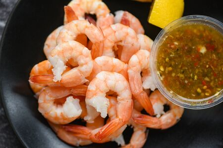 fresh shrimps served on plate with seafood sauce  boiled peeled shrimp prawns cooked in the restaurant