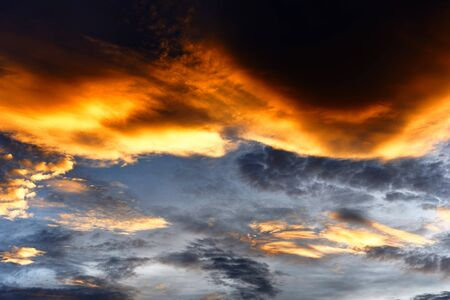Dramatic sky sunset or sunrise colorful red and orange sky over and cloud beautiful multicolor fiery background