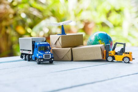logistics transport import export shipping service Customers order things from via internet International shipping online concept Air courier Cargo plane boxes packaging freight forwarder to worldwid