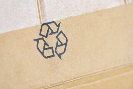 recycle concept  recycle logo on parcel package cardboard box , selective focus Imagens
