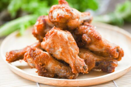 Fried chicken wings on wooden plate  Baked chicken wings BBQ 스톡 콘텐츠
