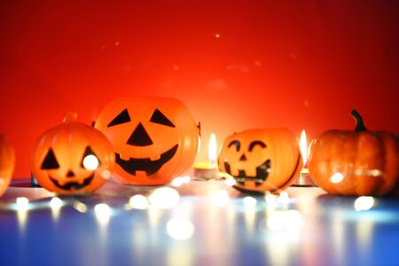 Halloween background candlelight orange decorated holidays festive concept  funny faces jack o lantern pumpkin halloween decorations for party accessories object with candle light bokeh