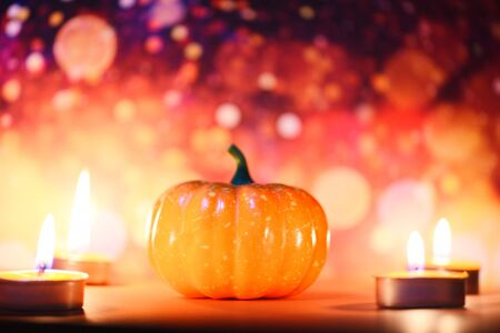 Halloween background candlelight orange decorated holidays festive concept  pumpkin halloween decorations for party accessories object with candle light bokeh