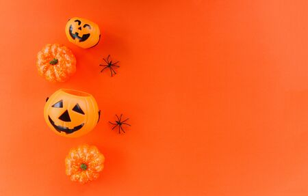 halloween background orange decorated holidays festive concept / spider and jack o lantern pumpkin halloween decorations for party accessories object , top view aerial image flat lay copy space