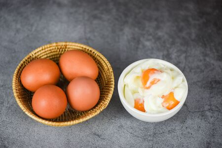 boiled egg on bowl and fresh eggs on the basket / Soft boiled eggs