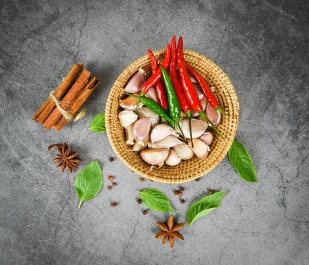 herbs and spices ingredients Thai Food Asian spicy soup with cinnamon star anise pepper seed vegetables basil leaf for red and green chilli garlic in the basket