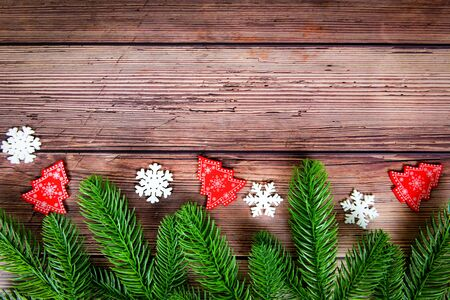 Christmas background composition fir branches pine and snow on wooden  christmas decoration pine tree festive xmas winter and Happy New Year object holiday concept , top view copy space Imagens