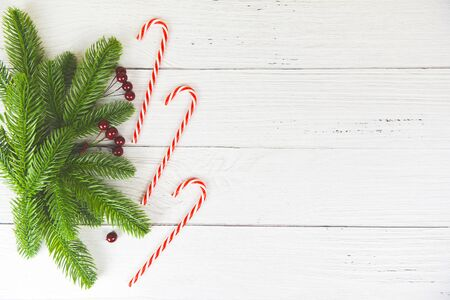 Christmas background wood composition fir branches pine and red berries  christmas decoration pine tree candy cane festive xmas winter and Happy New Year object holiday concept , top view  Stockfoto