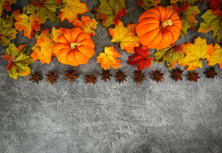 Autumn table setting with pumpkins holiday  Thanksgiving background frame autumn leaf and star anise spices decoration festive on wooden , top view copy space Stok Fotoğraf