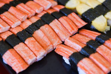 Sushi menu set Japanese cuisine fresh ingredients on tray  Japanese food sushi crab stick with nori roll in the restaurant Imagens