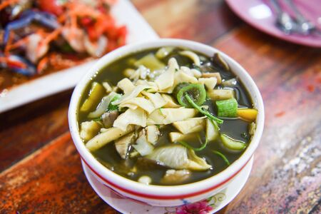 bamboo shoot soup and mushroom herbs and spices ingredients Thai food served on table  Tradition northeast food Isaan delicious on bowl with vegetables - Thai menu Asian food Imagens