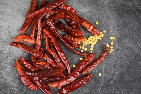 Red chili pepper seed  dried chillies on dark background , top view