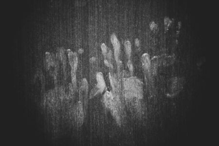 Hand marks on wooden wall / hand prints Horror scary dirty fingerprint The concept of loneliness and abandonment and Horror scary Ghost in home door on Halloween Stok Fotoğraf - 131285946